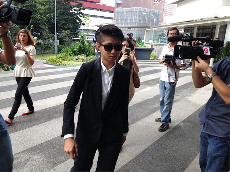 Sam Lo, aka Sticker Lady, turned up for her day in court dressed sharply in a suit.