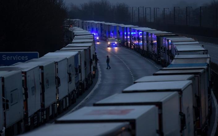 Lorries queue on the M20 on December 21, 2020 in Sellindge, Kent, after France temporarily closed its border with the UK - Dan Kitwood/Getty Images Europe
