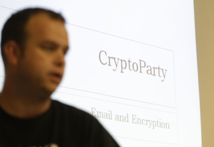 "In this Thursday, July 18, 2013, photo, information technology professional Josh Scott speaks at a monthly ""Cryptoparty"" in Dallas. Across the Internet, users are talking about changes small and large, from using more encryption and stronger passwords to much more extreme measures such as ditching cellphones and using cash over credit cards. The conversations play out daily on Reddit, Twitter and other networks, and have spread to offline life with so-called ""Cryptoparty"" gatherings in cities including Dallas, Atlanta and Oakland, Calif. (AP Photo/LM Otero)"