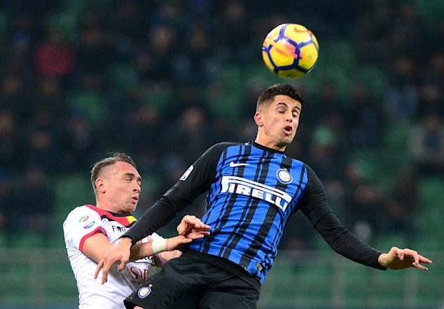 Soccer Football - Serie A - Inter Milan vs Benevento Calcio - San Siro, Milan, Italy - February 24, 2018 Inter Milan's Joao Cancelo in action with Benevento's Gaetano Letizia REUTERS/Massimo Pinca