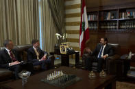 U.S. Undersecretary of State for Political Affairs David Hale, center left, meets with with former Lebanese Prime Minister Saad Hariri in downtown Beirut, Lebanon, Friday, Dec. 20, 2019. Hale is the most senior foreign diplomat to visit the country since the political crisis. (AP Photo/Maya Alleruzzo)