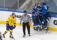 Sweden's Albin Sundsvik (29) looks on as Finland celebrates a goal during the third period of an IIHL World Junior Hockey Championship game, Saturday, Jan. 2, 2021 in Edmonton, Alberta. (Jason Franson/The Canadian Press via AP)