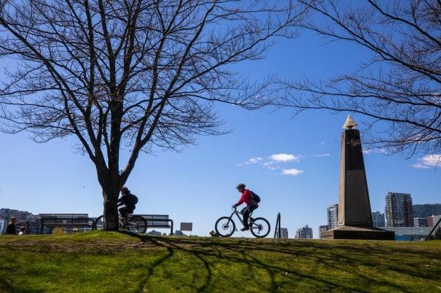 A cyclist is pictured along the seawall in Vancouver on Monday.