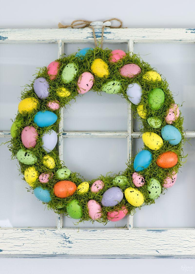 """<p>If your Easter decorations could use a serious dose of color, you definitely should make this wreath. With multi-hued eggs and bright-green moss, your Easter décor will pop in no time.</p><p><strong>Get the tutorial at <a href=""""https://www.thenavagepatch.com/cheerful-spring-wreath-and-tree/"""" rel=""""nofollow noopener"""" target=""""_blank"""" data-ylk=""""slk:The Navage Patch"""" class=""""link rapid-noclick-resp"""">The Navage Patch</a>.</strong></p><p><a class=""""link rapid-noclick-resp"""" href=""""https://go.redirectingat.com?id=74968X1596630&url=https%3A%2F%2Fwww.walmart.com%2Fip%2FMeadow-Green-Rust-Oleum-American-Accents-2X-Ultra-Cover-Gloss-Spray-Paint-12-oz%2F250910520&sref=https%3A%2F%2Fwww.thepioneerwoman.com%2Fhome-lifestyle%2Fcrafts-diy%2Fg35698457%2Fdiy-easter-wreath-ideas%2F"""" rel=""""nofollow noopener"""" target=""""_blank"""" data-ylk=""""slk:SHOP SPRAY PAINT"""">SHOP SPRAY PAINT</a></p>"""