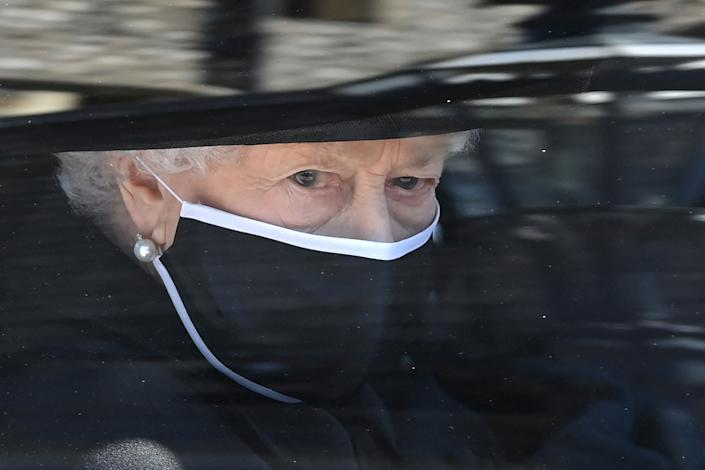 Britain's Queen Elizabeth II arrives in the Royal Bentley at the funeral for her husband, the Duke of Edinburgh, at St George's Chapel.  (Photo: LEON NEAL via Getty Images)