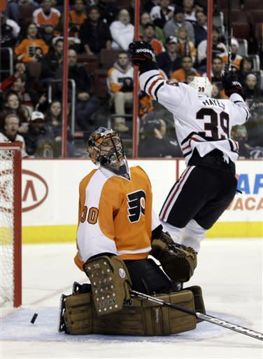 Philadelphia Flyers' Ilya Bryzgalov (30), of Russia, reacts after giving up a goal to Chicago Blackhawks' Jimmy Hayes (39) in the first period of an NHL hockey game on Thursday, Jan. 5, 2012, in Philadelphia. (AP Photo/Matt Slocum)