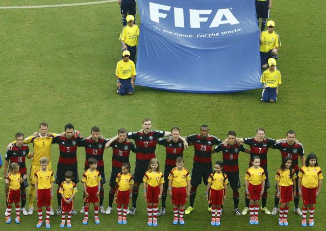 Germany's national soccer players stand before the 2014 World Cup Group G soccer match between the U.S. and Germany at the Pernambuco arena in Recife June 26, 2014. REUTERS/Ruben Sprich (BRAZIL - Tags: SOCCER SPORT WORLD CUP)