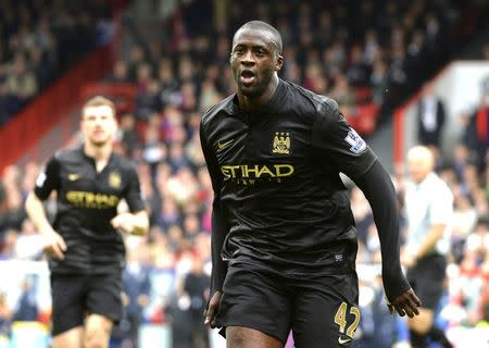 Manchester City's Yaya Toure (C) celebrates scoring a goal against Crystal Palace during their English Premier League soccer match at Selhurst Park in London April 27, 2014. REUTERS/Toby Melville/Files