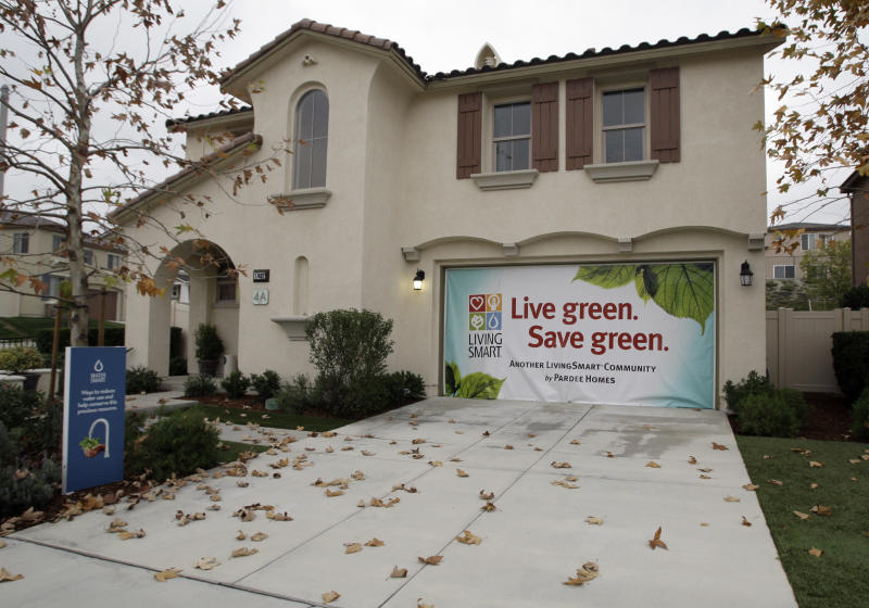 In this Dec. 15, 2010 photo, a sign touting the 'green' aspect of Pardee Homes' Fair Oaks Ranch is seen on a model home at the development in Santa Clarita, Calif. More people purchased new homes in November, but not enough to signal better times are ahead for the battered housing industry. (AP Photo/Reed Saxon)