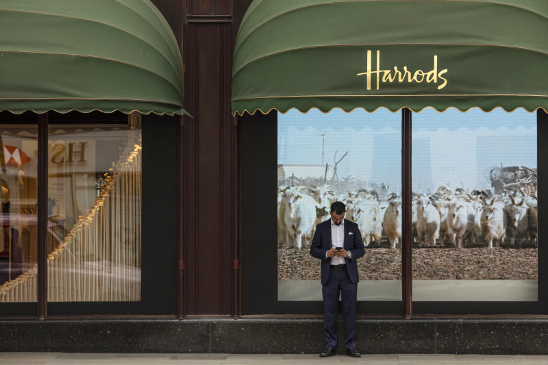 LONDON, ENGLAND - OCTOBER 11: A man checks his phone outside the department store Harrods, near the home of Zamira Hajiyeva, the wife of Azerbaijan state banker Jahangir Hajiyev, on October 11, 2018 in London, England. Zamira Hajiyeva is the subject of the first two unexplained wealth orders obtained by the UK National Crime Agency. Hajiyeva's husband, Azerbaijan state banker Jahangir Hajiyev was jailed in his home country for embezzlement. Under the wealth orders she will need to explain a decade of spending in the Knightsbridge luxury goods store Harrods, where her bill to date is £16million GBP and how she paid for two London properties worth a total of £22million GBP. (Photo by Dan Kitwood/Getty Images)