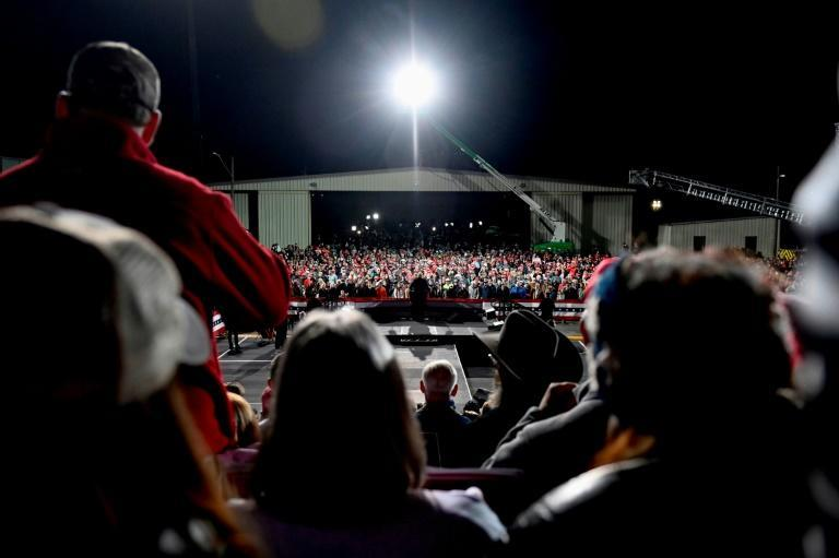 Supporters listen as US President Donald Trump speaks at a rally to support Republican Senate candidates at Valdosta Regional Airport in Valdosta, Georgia on December 5, 2020