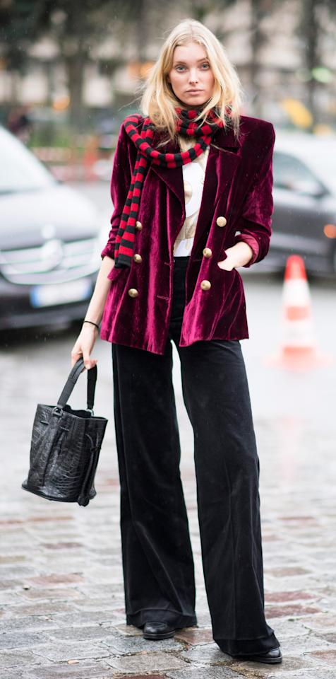 <p>Elsa Hosk showed us her model off duty style while out in Paris. The model wore a vintage-esque velvet blazer, wide leg trousers, a striped scarf, and a sleek bucket bag.</p>