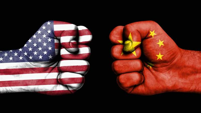 Conflict between USA and China, male fists - governments conflict concept