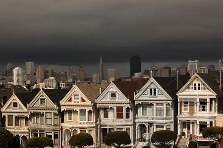 "A row of Victorian homes known locally as the ""Painted Ladies"" glow in the early evening sun following a rain shower in San Francisco"