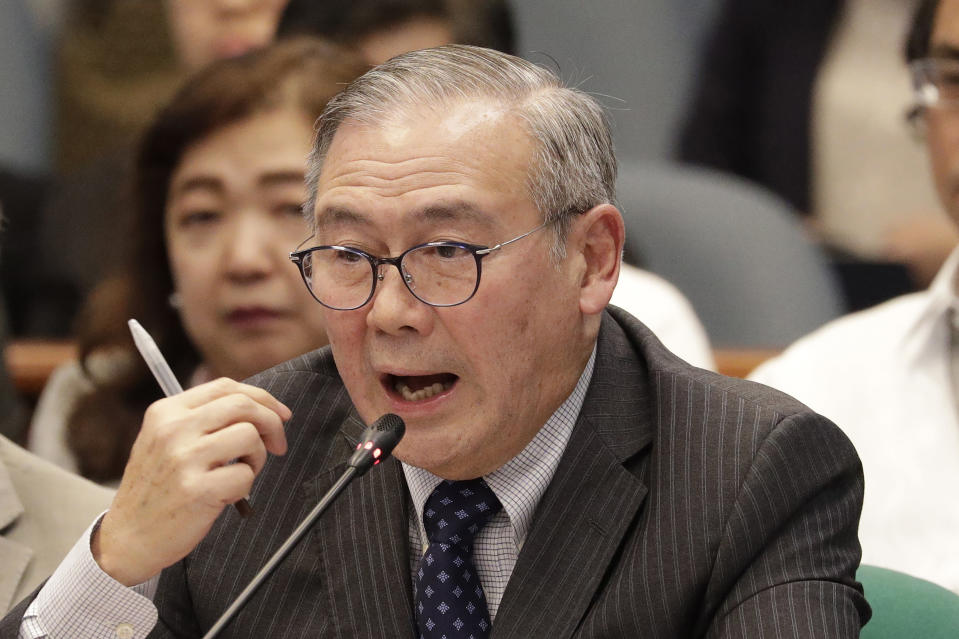 FILE - In this Feb. 6, 2020, file photo, Philippine Secretary of Foreign Affairs Teodoro Locsin Jr. gestures during a senate hearing in Manila, Philippines. The Philippine government has protested the Chinese coast guard's harassment of Philippine coast guard ships patrolling a disputed shoal in the South China Sea, the Department of Foreign Affairs said Monday, May 3, 2021. (AP Photo/Aaron Favila, File)