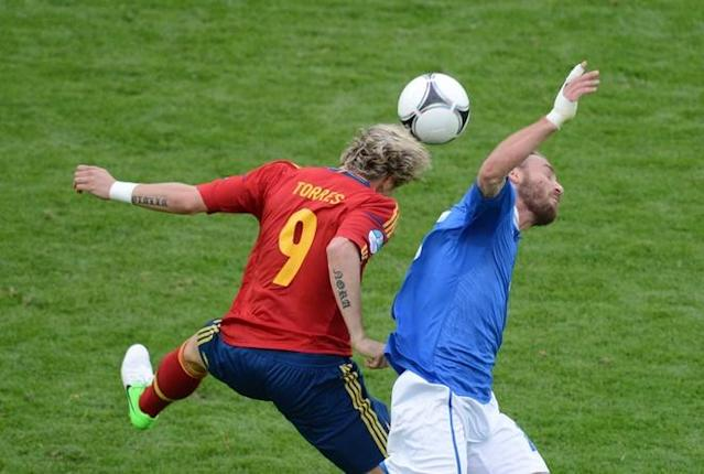 Spanish forward Fernando Torres (L) vies during the Euro 2012 championships football match Spain vs Italy on June 10, 2012 at the Gdansk Arena. AFPPHOTO/ PATRIK STOLLARZPATRIK STOLLARZ/AFP/GettyImages