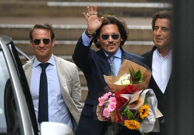 Actor Johnny Depp (centre) is bringing a libel claim against The Sun newspaper (Dominic Lipinski/PA)
