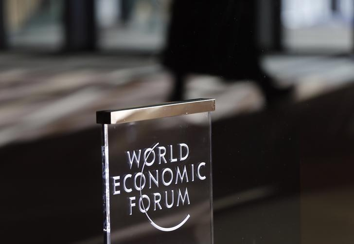 People leave the annual meeting of the World Economic Forum in Davos