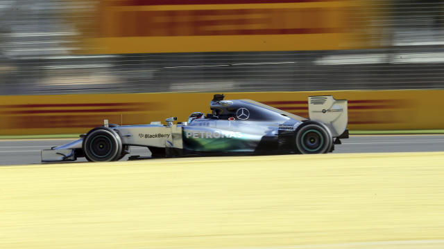 Mercedes driver Lewis Hamilton of Britain controls his car on turn five during the second practice session at Albert Park ahead of the Australian Formula One Grand Prix in Melbourne, Australia, Friday, March 14, 2014. (AP Photo/Rob Griffith)