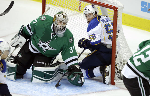 St. Louis Blues left wing Magnus Paajarvi (56) of Sweden is caught in the net against Dallas Stars goalie Dan Ellis (30) during the first period of an NHL pre-season hockey game Sunday, Sept. 15, 2013, in Dallas. (AP Photo/LM Otero)
