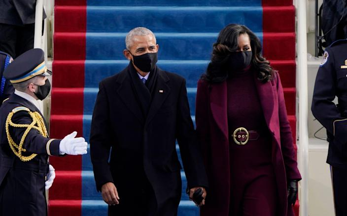 Former President Barack Obama and his wife Michelle arrive for the 59th Presidential Inauguration at the U.S. Capitol for President-elect Joe Biden in Washington, Wednesday, Jan. 20, 2021 - AP