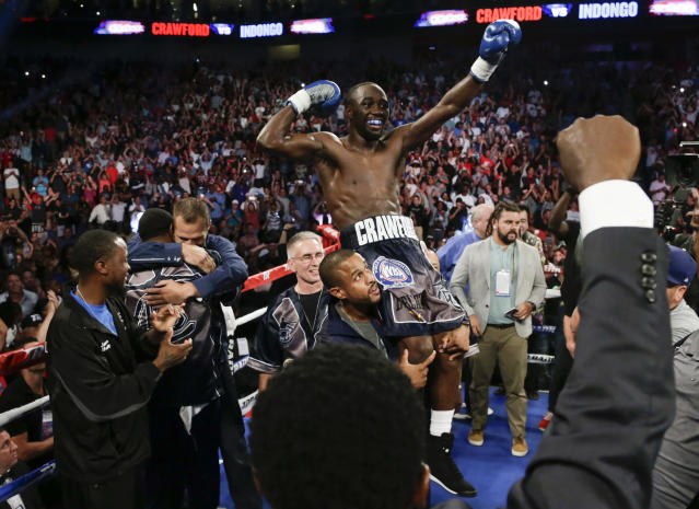 "Terence ""Bud"" Crawford celebrates his third-round knockout victory of Julius Indongo Saturday in Lincoln, Neb., that made him the undisputed super lightweight champion. (AP Photo/Nati Harnik)"