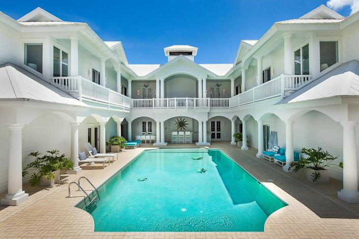 Exterior and pool at Sea Oats Luxury Estate