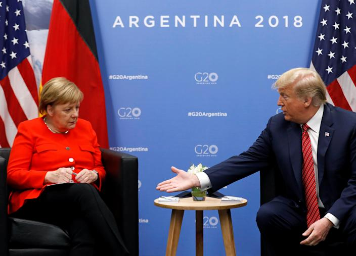 President Donald Trump and German Chancellor Angela Merkel attend a meeting during the G20 leaders summit in Buenos Aires, Argentina, Dec. 1, 2018. (Photo: Kevin Lamarque/Reuters)