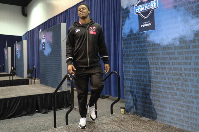 Ohio State defensive lineman Chase Young walks on the stage for a press conference at the NFL football scouting combine in Indianapolis, Thursday, Feb. 27, 2020. (AP Photo/AJ Mast)