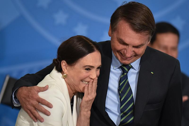 Alongside President Jair Bolsonaro, famous Brazilian novel actress, Regina Duarte, reacts during her inauguration ceremony as new Brazil`s Culture Secretary, at the Planalto Palace in Brasília, Brazil on March 4, 2020. Duarte takes over from Roberto Alvim, who was fired in January after publishing a video with references to Nazi cultural propaganda. (Photo by Andre Borges/NurPhoto via Getty Images)