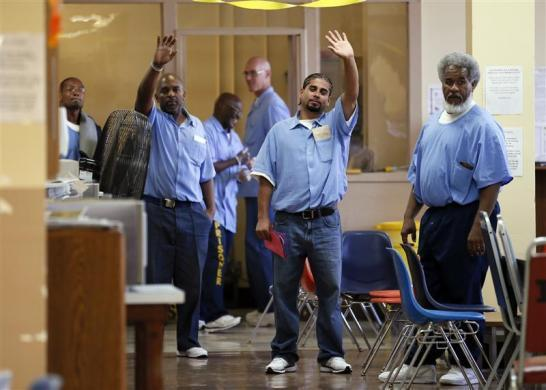 Fathers wave goodbye to their children after a visit at San Quentin state prison in San Quentin, California June 8, 2012.