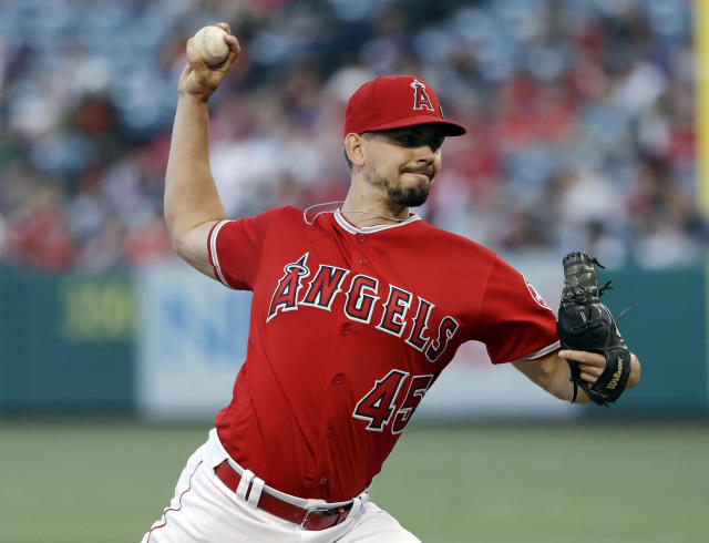 Los Angeles Angels starting pitcher Taylor Cole throws to a Seattle Mariners batter during the first inning of a baseball game Friday, July 12, 2019, in Anaheim, Calif. (AP Photo/Marcio Jose Sanchez)