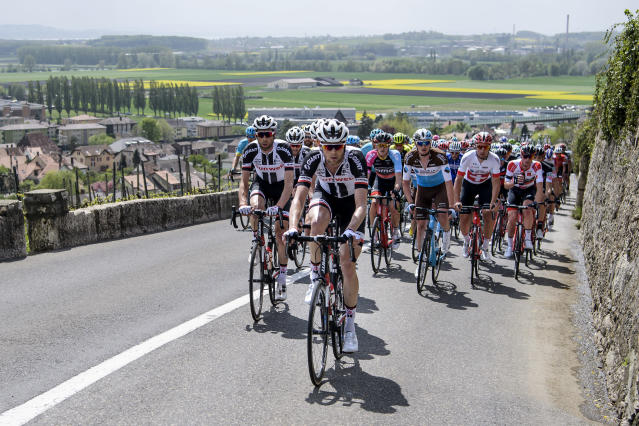 The pack rides during the first stage, a 166,6 km race between Fribourg and Delemont during the 72th Tour de Romandie UCI ProTour cycling race in Le Landeron, Switzerland, Wednesday, April 25, 2018. (Jean-Christophe Bott/Keystone via AP)