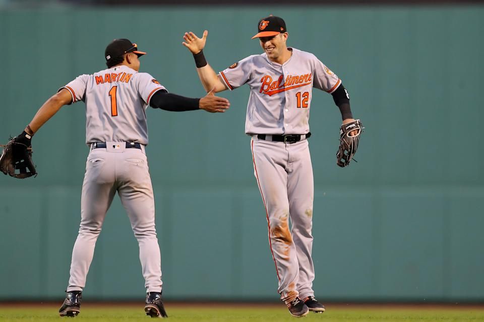 BOSTON, MASSACHUSETTS - SEPTEMBER 29: Stevie Wilkerson #12 of the Baltimore Orioles celebrates with Richie Martin #1 after catching a fly ball from Jackie Bradley Jr. #19 of the Boston Red Sox during the eighth inning at Fenway Park on September 29, 2019 in Boston, Massachusetts. (Photo by Maddie Meyer/Getty Images)