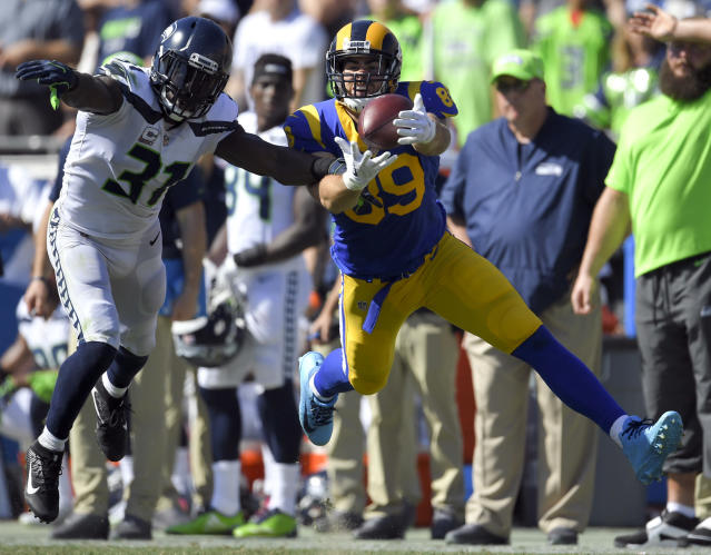 "FILE - In this Sunday, Oct. 8, 2017, file photo, Seattle Seahawks strong safety Kam Chancellor, left, breaks up a pass intended for Los Angeles Rams tight end Tyler Higbee during the first half of an NFL football game in Los Angeles. In a posting on his Twitter account Sunday, July 1, 2018, Chancellor said scans on his injured neck have shown no improvement and declared it was ""time for the next chapter."" (AP Photo/Mark J. Terrill, File)"