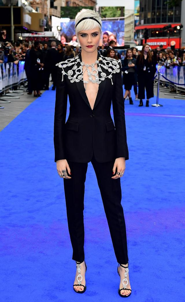<p>Delevingne continued her suit streak, choosing a tailored slim-fitting style by British brand Burberry. A bespoke bejewelled cape adorned her shoulders with matching sandals providing the perfect finishing touch. (Photo: PA) </p>