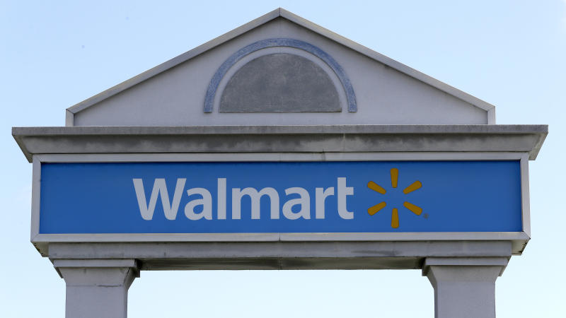 FILE - In this Sept. 3, 2019, file photo, a Walmart logo forms part of a sign outside a Walmart store, in Walpole, Mass. Walmart Inc. reports earnings Thursday, Nov. 14. (AP Photo/Steven Senne, File)