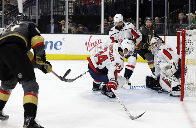 Vegas Golden Knights left wing Max Pacioretty, left, scores on Washington Capitals goalie Braden Holtby (70) during the second period of an NHL hockey game Monday, Feb. 17, 2020, in Las Vegas. (AP Photo/Isaac Brekken)