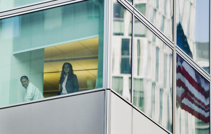 Office workers inside of the Goldman Sachs headquarters