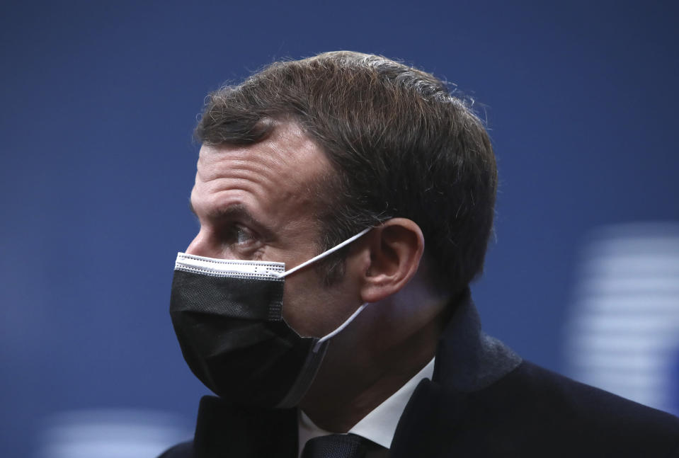 French President Emmanuel Macron arrives for an EU summit at the European Council building in Brussels, Thursday, Dec. 10, 2020. European Union leaders meet for a year-end summit that will address anything from climate, sanctions against Turkey to budget and virus recovery plans. Brexit will be discussed on the sidelines. (Yves Herman, Pool via AP)