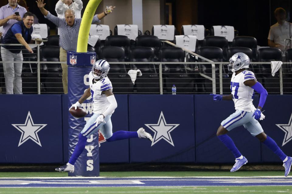 Dallas Cowboys cornerback Trevon Diggs (7) and safety Jayron Kearse (27) celebrate after Diggs intercepted a Philadelphia Eagles' Jalen Hurts pass and returned it for a touchdown in the second half of an NFL football game in Arlington, Texas, Monday, Sept. 27, 2021. (AP Photo/Ron Jenkins)