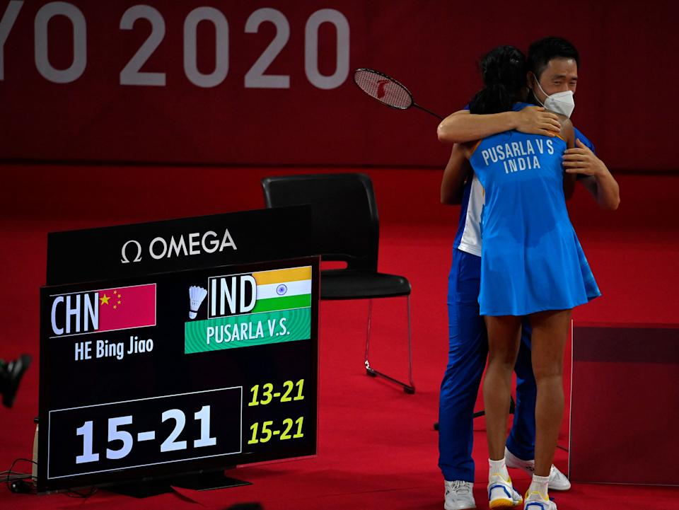 India's P. V. Sindhu celebrates with a coach after beating China's He Bingjiao in their women's singles badminton bronze medal match during the Tokyo 2020 Olympic Games at the Musashino Forest Sports Plaza in Tokyo on August 1, 2021. (Photo by Alexander NEMENOV / AFP) (Photo by ALEXANDER NEMENOV/AFP via Getty Images)