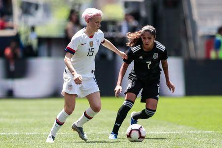 May 26, 2019; Harrison, NJ, USA; United States forward Megan Rapinoe (15) controls the ball as Mexico forward defends during the first half of a Countdown to the Cup Women's Soccer match at Red Bull Arena. Mandatory Credit: Vincent Carchietta-USA TODAY Sports