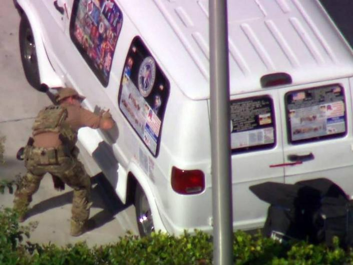 An FBI agent investigates the van believed to belong to Cesar Syoc (AFP/Getty)