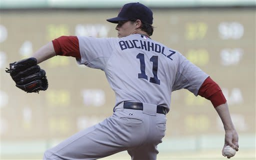 Boston Red Sox starting pitcher Clay Buchholz throws during the first inning of a baseball game against the Texas Rangers on Tuesday, July 24, 2012, in Arlington, Texas. (AP Photo/LM Otero)