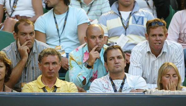 MELBOURNE, AUSTRALIA - JANUARY 18: (L-R) Jacques Kallis, Herschelle Gibbs and Shaun Pollock of the South African cricket team watch the centre court action during day three of the Australian Open at Melbourne Park January 18, 2006 in Melbourne, Australia. (Photo by Mark Kolbe/Getty Images)