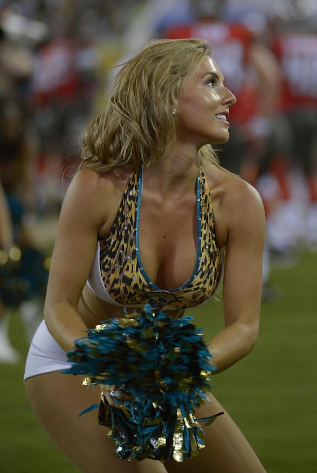 A Jacksonville Jaguar cheerleader performs during the second half of an NFL preseason football game against the Tampa Bay Buccaneers in Jacksonville, Fla., Friday, Aug. 8, 2014. (AP Photo/Phelan M. Ebenhack)