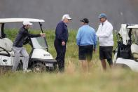 U.S. President Donald Trump plays golf at the Trump National Golf Club in Sterling, Virginia