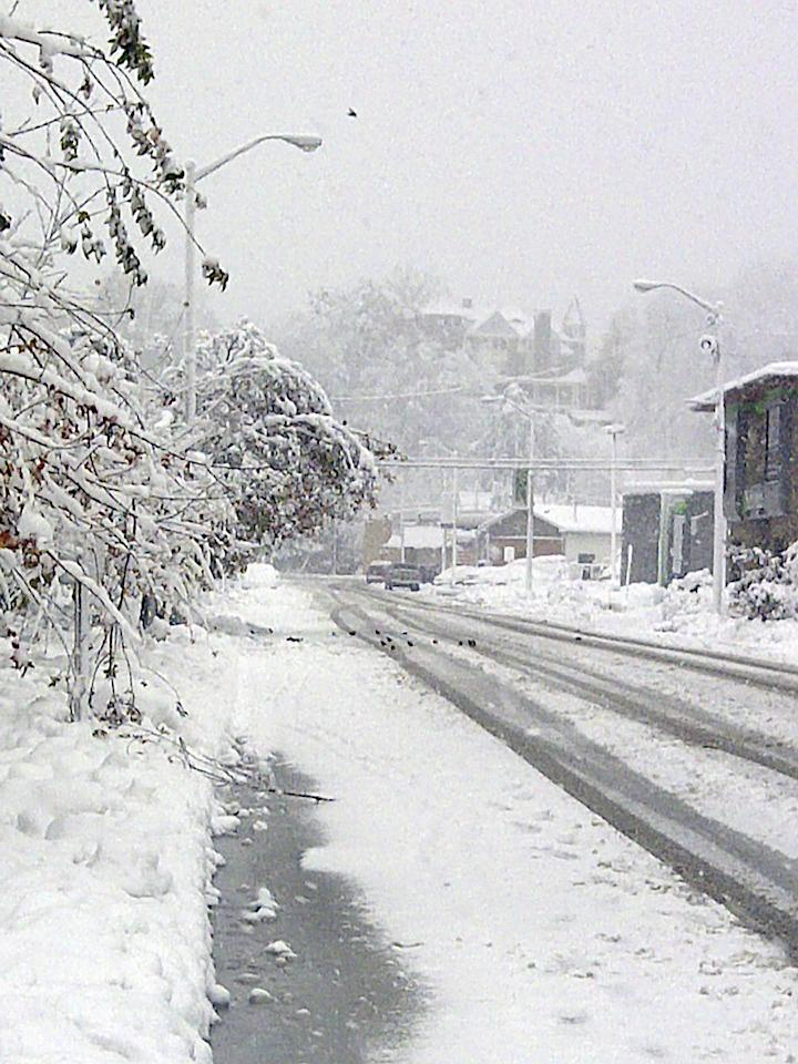 Snow covers the streets Tuesday, Oct. 30, 2012, after superstorm Sandy moved through Elkins, W.Va. Sandy buried parts of West Virginia under more than a foot of snow on Tuesday, cutting power to at least 243,000 customers and closing dozens of roads. At least one death was reported. (AP Photo/Vicki Smith)