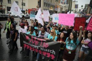 Supporters participating in the 2017 protest march for survivors of sexual assault in Hollywood, Los Angeles. Image: Lucy Nicholson